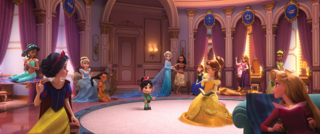 "ROYAL REUNION – In ""Ralph Breaks the Internet: Wreck It Ralph 2,"" Vanellope von Schweetz—along with her best friend Ralph—ventures into the uncharted world of the internet. When she finds herself surrounded by Disney princesses, she's surprised to learn that she actually has a lot in common with them. The scene, highlighted in a new trailer for the film, features several of the original princess voices, including Auli'i Cravalho (""Moana""), Kristen Bell (Anna in ""Frozen""), Idina Menzel (Elsa in ""Frozen""), Kelly MacDonald (Merida in ""Brave""), Mandy Moore (Rapunzel in ""Tangled""), Anika Noni Rose (Tiana in ""The Princess and the Frog""), Ming-Na Wen (""Mulan""), Irene Bedard (""Pocahontas""), Linda Larkin (Jasmine in ""Aladdin""), Paige O'Hara (Belle in ""Beauty and the Beast"") and Jodi Benson (Ariel in ""The Little Mermaid""). Featuring Sarah Silverman as the voice of Vanellope, ""Ralph Breaks the Internet: Wreck It Ralph 2"" opens in theaters nationwide Nov. 21, 2018...©2018 Disney. All Rights Reserved."